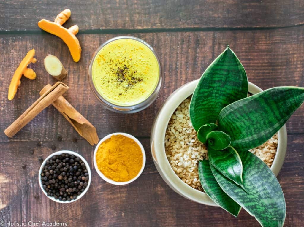 Turmeric latte with ingredients ready to drink