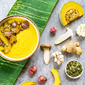 pumpkin soup ready to eat with the raw ingredients