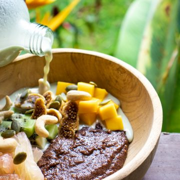 teff porridge with pumpkin seed milk and mango