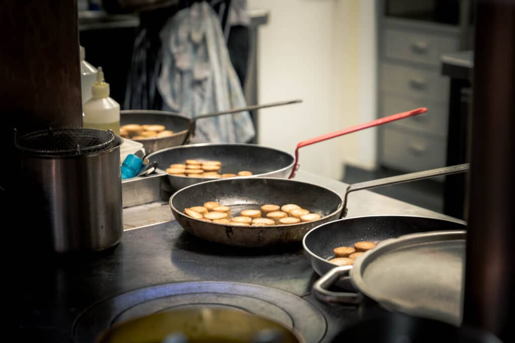 frying pans laid out ready for a busy service