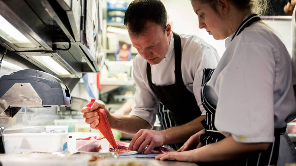 Chef Jamie teaching students