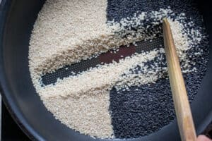 toasting the sesame seeds in a dry pan on medium heat