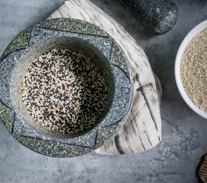 making gomashio in a mortar and pestle