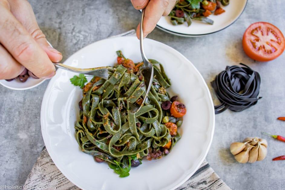 eating pasta puttanesca
