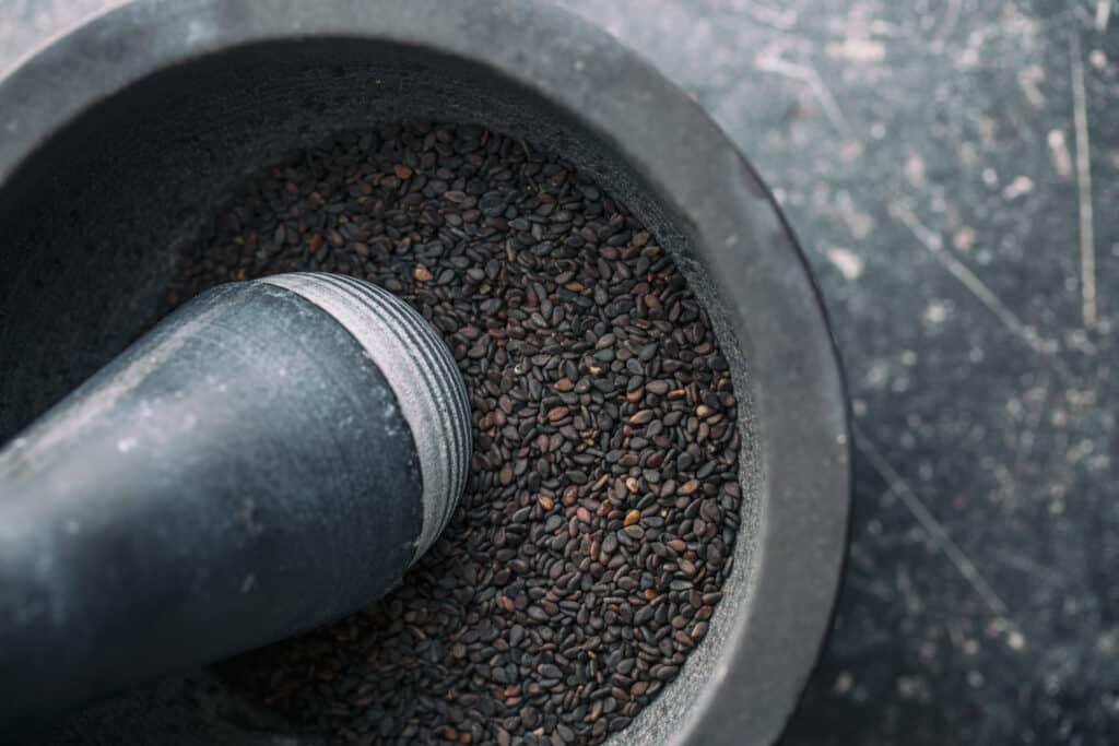 black sesame in a mortor and pestle