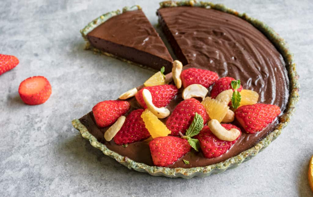 raw vegan cheesecake sliced ready to serve and looking delicious