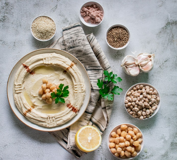 historic chickpea dip laid out with all the healthy ingredients it's composed of.