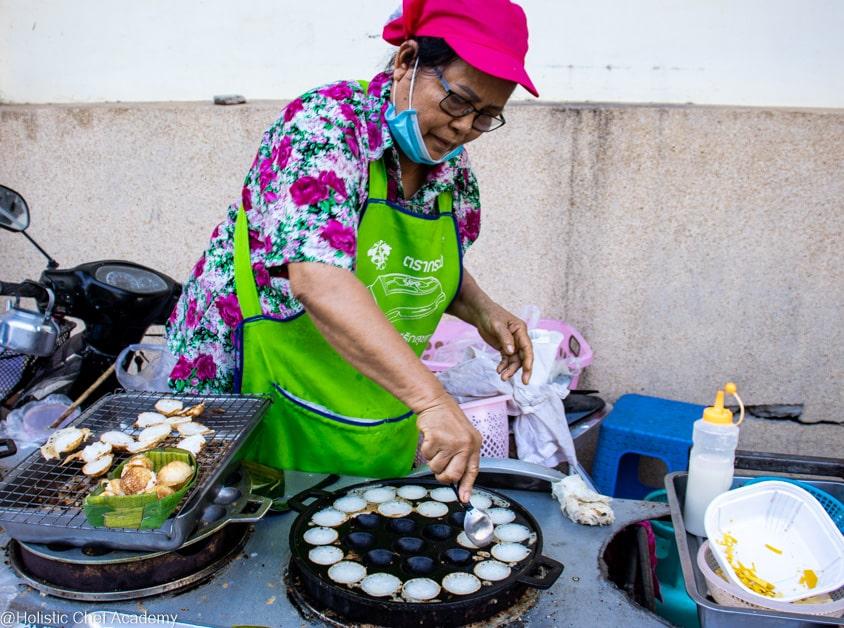 making coconut dumplings in the morning market in Phuket