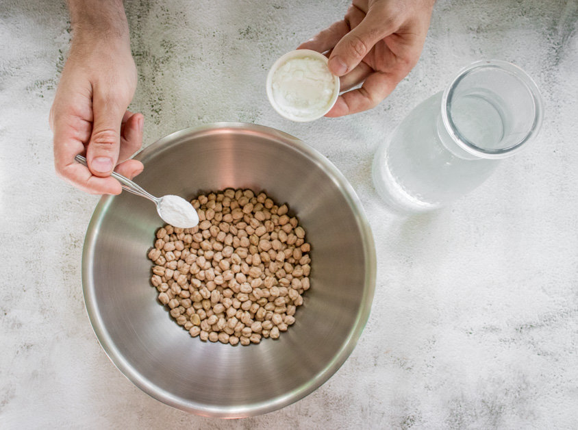 adding baking soda and water to dried chickpeas for the perfect hummus