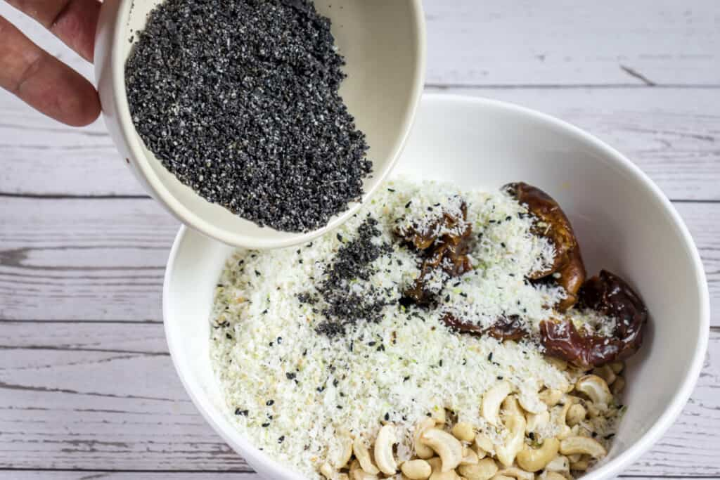 adding-coconut-flakes-and-black-sesame-powder