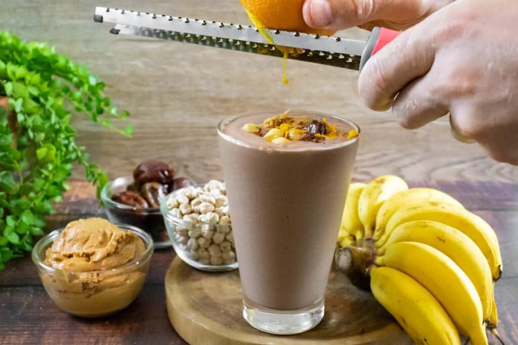 chickpea-cacao-banana-smoothie-garnished-with-orange-zest