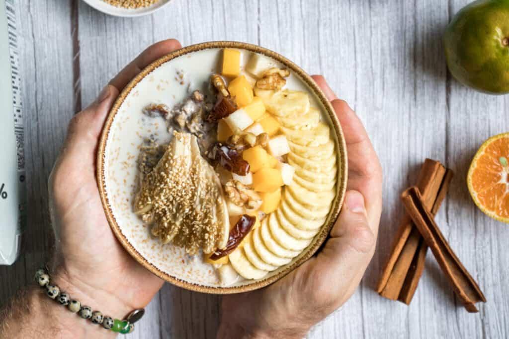 serving-a-bowl-sesame-milk-oats-with-fresh-fruits