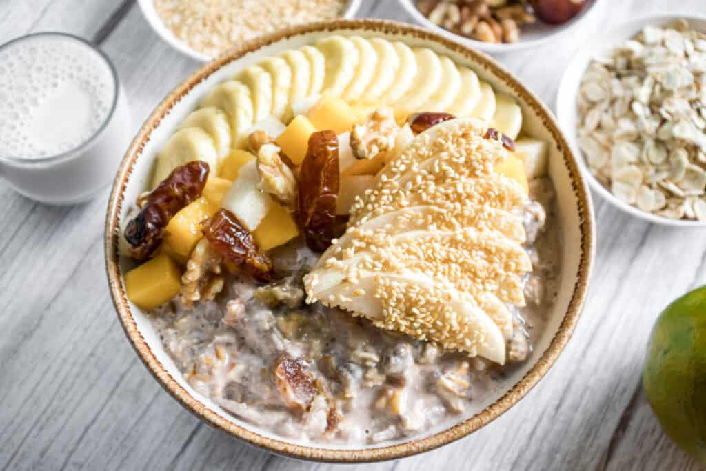 sesame-bircher-garnished-with-Asian=pear-and-sesame