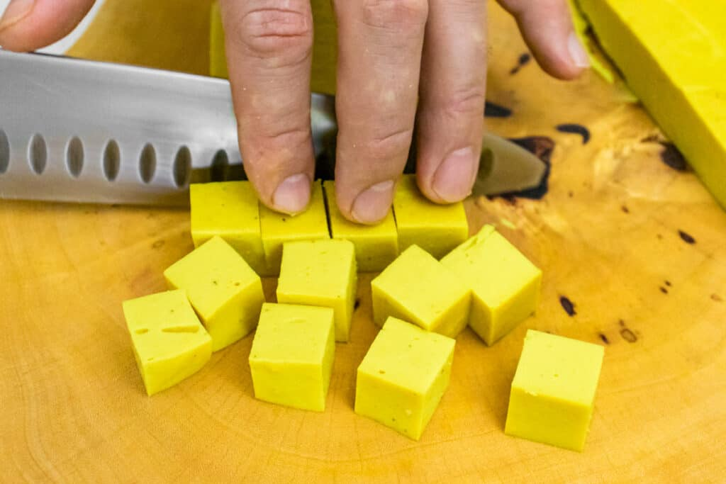 cutting-up-chickpea-tofu-with-a-knife