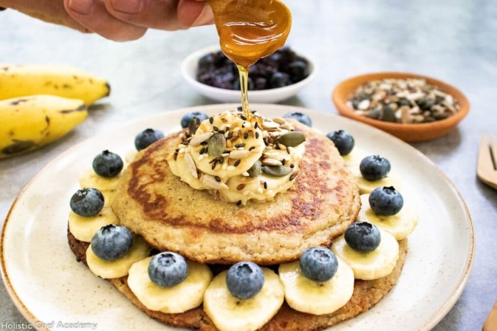 drizzling-syrup-over-vegan-pancakes