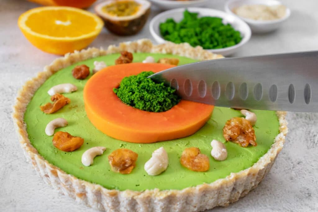 cutting-a-slice-of-vegan-cheesecake