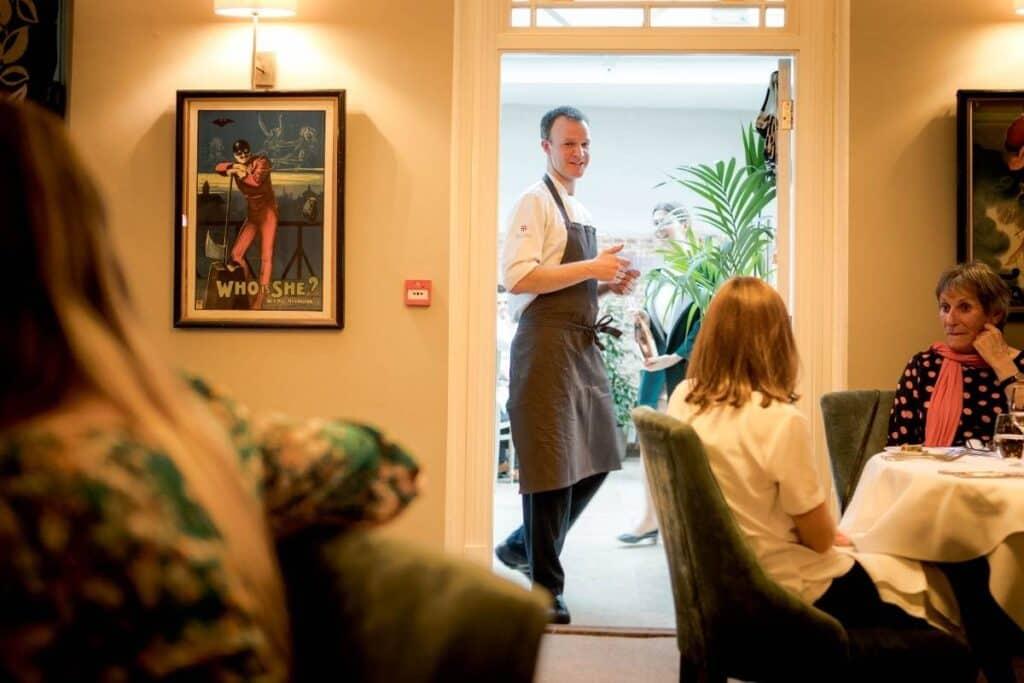 jamie-talking-in-a-restaurant