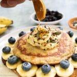 vegan-banana-pancakes-getting-drizzled-with-honey